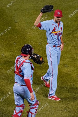 St. Louis Cardinals relief pitcher Andrew Miller, right, celebrates with catcher Matt Wieters after they defeated the Chicago Cubs in the second baseball game of a doubleheader in Chicago
