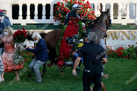 Trainer Bob Baffert is knocked to ground as Jockey John Velazquez try to control Authentic in the winners' circle after winning the 146th running of the Kentucky Derby at Churchill Downs, in Louisville, Ky