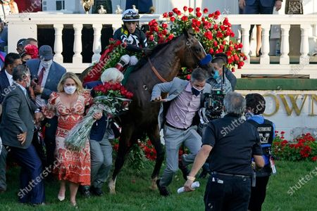 Trainer Bob Baffert attempts to get out of the way as Jockey John Velazquez tries to control Authentic in the winners' circle after winning the 146th running of the Kentucky Derby at Churchill Downs, in Louisville, Ky