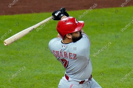 Cincinnati Reds' Eugenio Suarez follows through on a solo home run, his third homer of the game, off Pittsburgh Pirates relief pitcher Derek Holland in the eighth inning of a baseball game in Pittsburgh, . The Reds won 6-2