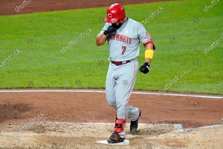 Stock Picture of Cincinnati Reds' Eugenio Suarez steps on home plate after hitting a solo home run, his third homer of the night, off Pittsburgh Pirates relief pitcher Derek Holland during the eighth inning of a baseball game in Pittsburgh, . The Reds won 6-2
