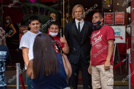 Stock Picture of Visitors pose with a wax likeness of Brad Pitt outside Madame Tussauds Times Square