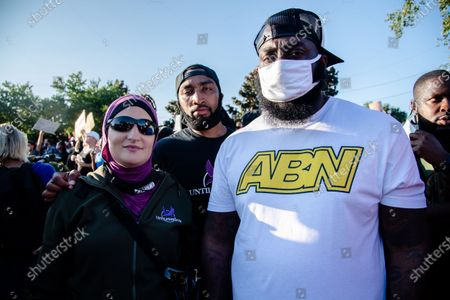Linda Sarsour, left, and Mysonne Linen, center, of Until Freedom gather outside of Churchill Downs demanding justice for Breonna Taylor during Derby Weekend on September 5, 2020 in Louisville, KY.