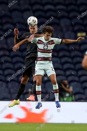 Joao Felix (R) of Portugal vies with Dejan Lovren of Croatia during the UEFA Nations League group football match between Portugal and Croatia at the Dragao stadium in Porto, Portugal on Sept. 5, 2020.