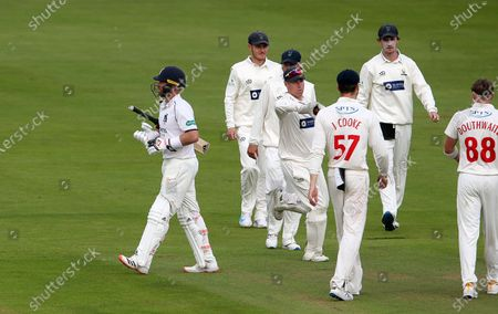Ian Bell of Warwickshire walks off after being caught by Tom Cullen.