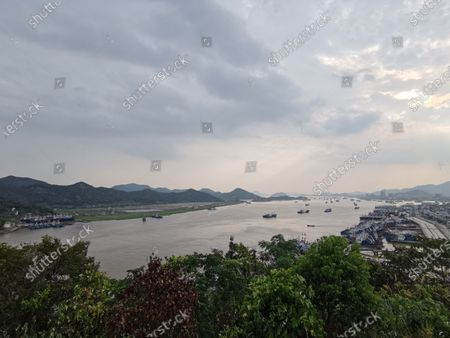 Dongmen Fishing Village, Xiangshan County, Ningbo city, Zhejiang Province, Aug. 25, 2020. Dongmen Fishing Village, located on Dongmen Island of Shipu Town, Xiangshan County, Zhejiang Province, across the harbor from the urban area of Shipu Town, has 240 high-horsepower steel fishing boats. On April 19, 2020, dongmen Fishing Village was selected into the list of the sixth batch of famous historical and cultural towns and villages in Zhejiang Province. As early as the second year of Tang Shenlong, that is, in 706 AD, Dongmen Fishing Village in Xiangshanli County was one of the areas under its jurisdiction. By the Ming Dynasty, It was called Changguo Wei, the fourth David of China, together with Ningbo Wei, Dinghaiwei and Guanhaiwei. Moving from Zhoushan to Dongmen has established the position of strategic fortress. So up to now in Dongmen fishing village can still faintly see the anti-Japanese artillery and used as a protective wall. The 10-meter-high statue of Mazu faces the East China Sea, implying that the fishermen of Dongmen fishing village will be able to return safely from the sea under her protection. The street is the old street of Dongmen Fishing Village, which was built in the Qing Dynasty and has a history of 400 years since now. Due to the developed fishery and large population of Dongmen fishing village at that time, shops naturally formed to supply the fishing boats. At the north end of Zhi Street, there is the Temple of the Queen of Heaven, which backs on Guanji Mountain and faces Dongmen Port. The existing building was rebuilt in the 24th year of Jiaqing in the Qing Dynasty (1819). It is a place for villagers and fishermen to gather for entertainment, pray and give thanks. The Palace of The Queen of Heaven faces south. The gate tower connects the stage and chamber, and the main hall is a square quadrangle. Hall rest peak, five rooms.  East Zhejiang lighthouses are the name of a group of lighthouses in eastern Zhejiang province, China. These lighthouse