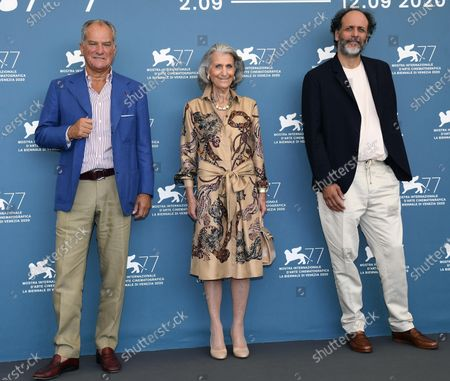 Luca Guadagnino (R), President of the Fondazione Ferragamo Giovanna Gentile Ferragamo (C) and Vice-President  Esecutivo of the Fondazione Ferragamo Leonardo Ferragamo (L) attend a photocall for 'Salvatore - Shoemaker of Dreams' at the 77th annual Venice International Film Festival, in Venice, Italy, 06 September 2020. The event is the first major in-person film fest to be held in the wake of the Covid-19 coronavirus pandemic. Attendees have to follow strict safety measures like mandatory face masks indoors, temperature scanners, and socially distanced screenings to reduce the risk of infection. The public is barred from the red carpet, and big stars are expected to be largely absent this year. The 77th edition of the festival runs from 02 to 12 September 2020.