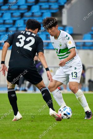 Stock Picture of Lee Tae-hee of Seongnam FC competes for the ball with Kim Bo-kyung of Jeonbuk Hyundai Motors FC