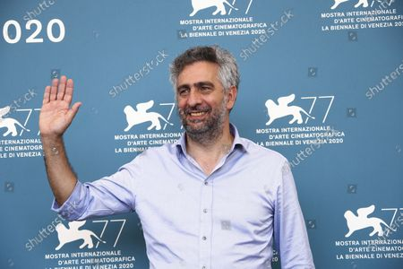 Director Salvatore Mereu poses for photographers at the photo call for the film 'Assandira' during the 77th edition of the Venice Film Festival in Venice, Italy