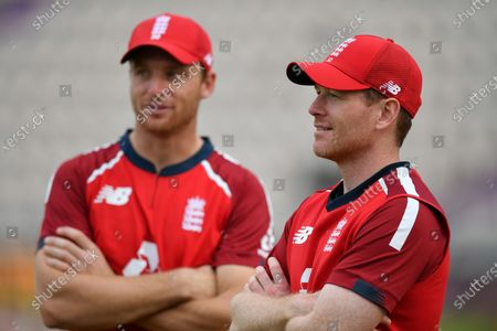 England's captain Eoin Morgan, right, with teammate Jos Buttler after their win in the second Twenty20 cricket match between England and Australia, at the Ageas Bowl in Southampton, England