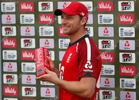 England's Jos Buttler poses with the Man of the Match award after their win in the second Twenty20 cricket match between England and Australia, at the Ageas Bowl in Southampton, England