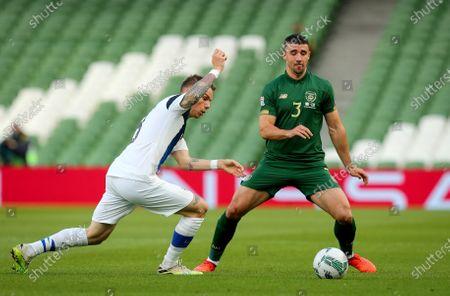 Republic of Ireland vs Finland. Ireland's Enda Stevens comes up against Robert Taylor of Finland