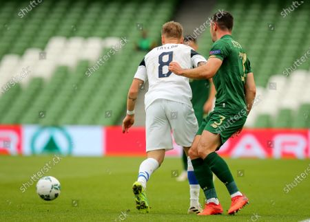 Republic of Ireland vs Finland. Ireland's Enda Stevens with Robert Taylor of Finland