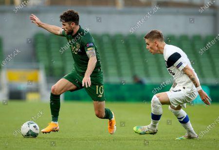 Republic of Ireland vs Finland. Ireland's Robbie Brady with Robert Taylor of Finland