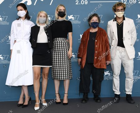 Stock Image of Katherine Waterston, Norwegian filmmaker Mona Fastvold, British actress Vanessa Kirby, producer Christine Vachon and US actor Christopher Abbott wear protective masks at a photocall for 'The World to Come' during the 77th annual Venice International Film Festival, in Venice, Italy, 06 September 2020. The movie is presented in the official competition 'Venezia 77' at the festival running from 02 September to 12 September. The event is the first major in-person film fest to be held in the wake of the Covid-19 coronavirus pandemic. Attendees have to follow strict safety measures like mandatory face masks indoors, temperature scanners, and socially distanced screenings to reduce the risk of infection. The public is barred from the red carpet, and big stars are expected to be largely absent this year.