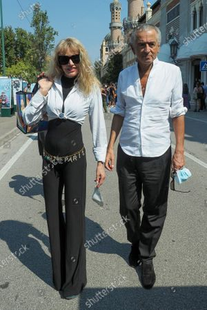 Stock Image of Arielle Dombasle and Bernard-Henri Levy are seen arriving at the Excelsior
