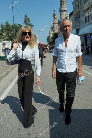 Arielle Dombasle and Bernard-Henri Levy are seen arriving at the Excelsior