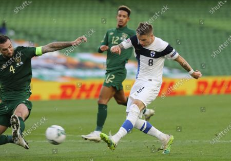 Finland's Robert Taylor shoots at goal as =il4- attempts to block during UEFA Nations League soccer match between Ireland and Finland at the Aviva stadium in Dublin, Ireland