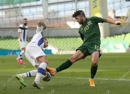 Ireland's Robbie Brady, right, is tackled by Finland's Robert Taylor during UEFA Nations League soccer match between Ireland and Finland at the Aviva stadium in Dublin, Ireland