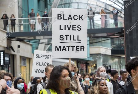 "; Bristol, UK. An All Black Lives UK ""Comeback March"" and rally takes place through Bristol city centre. Organisers of the Bristol protest have encouraged people to bring PPE (personal protective equipment). The All Black Lives group is youth-led and is separate to the Black Lives Matter movement, but both are united in striving for racial equality. All Black Lives UK are holding 'Comeback Marches' at several locations across the country today, including London, Bristol and Manchester, and have issued a series of demands: to end racial discrimination in the criminal justice, reform the education system, end racial health disparities, implement review recommendations, and stand with the Black community in the US. In Bristol the statue of slave trader Edward Colston was pulled down with ropes and thrown into Bristol docks on 07 June during an All Black Lives/Black Lives Matter protest that made headlines around the world. A month later in July a new sculpture titled ""A Surge of Power (Jen Reid) 2020"" by artist Marc Quinn was put up without permission from Bristol City council. Jen Reid was at the previous protest on 07 June which was in protest for the memory of George Floyd, a black man who was killed on May 25, 2020 in Minneapolis in the US by a white police officer kneeling on his neck for nearly 9 minutes. The killing of George Floyd has seen widespread protests in the US, the UK and other countries."