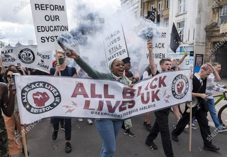 "Stock Photo of ; Bristol, UK. An All Black Lives UK ""Comeback March"" and rally takes place through Bristol city centre. Organisers of the Bristol protest have encouraged people to bring PPE (personal protective equipment). The All Black Lives group is youth-led and is separate to the Black Lives Matter movement, but both are united in striving for racial equality. All Black Lives UK are holding 'Comeback Marches' at several locations across the country today, including London, Bristol and Manchester, and have issued a series of demands: to end racial discrimination in the criminal justice, reform the education system, end racial health disparities, implement review recommendations, and stand with the Black community in the US. In Bristol the statue of slave trader Edward Colston was pulled down with ropes and thrown into Bristol docks on 07 June during an All Black Lives/Black Lives Matter protest that made headlines around the world. A month later in July a new sculpture titled ""A Surge of Power (Jen Reid) 2020"" by artist Marc Quinn was put up without permission from Bristol City council. Jen Reid was at the previous protest on 07 June which was in protest for the memory of George Floyd, a black man who was killed on May 25, 2020 in Minneapolis in the US by a white police officer kneeling on his neck for nearly 9 minutes. The killing of George Floyd has seen widespread protests in the US, the UK and other countries."