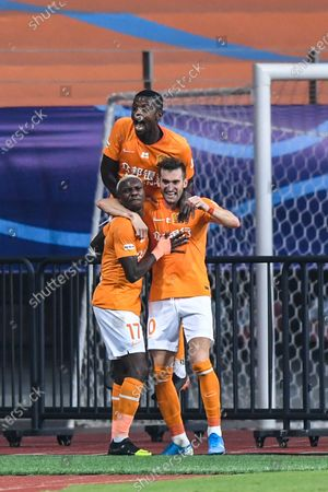 Jean Evrard Kouassi (bottom, L) of Wuhan Zall celebrates with his teammates after scoring a goal during the 9th round match between Wuhan Zall and Beijing Guoan at the postponed 2020 season Chinese Football Association Super League (CSL) Suzhou Division in Suzhou, east China's Jiangsu Province, Sept. 6, 2020.