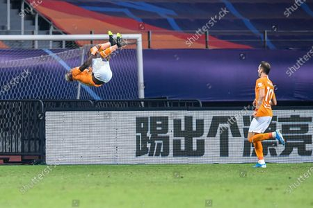 Jean Evrard Kouassi (L) of Wuhan Zall celebrates after scoring a goal during the 9th round match between Wuhan Zall and Beijing Guoan at the postponed 2020 season Chinese Football Association Super League (CSL) Suzhou Division in Suzhou, east China's Jiangsu Province, Sept. 6, 2020.