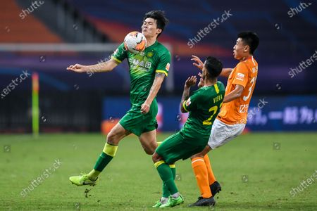 Kim Min-Jae (L) of Beijing Guoan vies during the 9th round match between Wuhan Zall and Beijing Guoan at the postponed 2020 season Chinese Football Association Super League (CSL) Suzhou Division in Suzhou, east China's Jiangsu Province, Sept. 6, 2020.