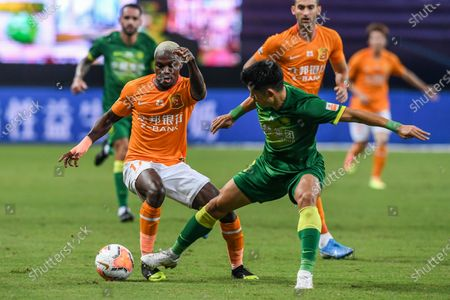 Jean Evrard Kouassi (L) of Wuhan Zall vies during the 9th round match between Wuhan Zall and Beijing Guoan at the postponed 2020 season Chinese Football Association Super League (CSL) Suzhou Division in Suzhou, east China's Jiangsu Province, Sept. 6, 2020.