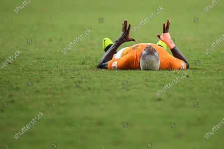 Jean Evrard Kouassi of Wuhan Zall lies on the pitch after the 9th round match between Wuhan Zall and Beijing Guoan at the postponed 2020 season Chinese Football Association Super League (CSL) Suzhou Division in Suzhou, east China's Jiangsu Province, Sept. 6, 2020.