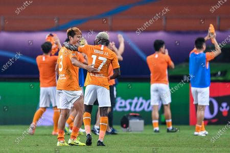 Liu Yi (L) of Wuhan Zall talks to his teammate Jean Evrard Kouassi after the 9th round match between Wuhan Zall and Beijing Guoan at the postponed 2020 season Chinese Football Association Super League (CSL) Suzhou Division in Suzhou, east China's Jiangsu Province, Sept. 6, 2020.