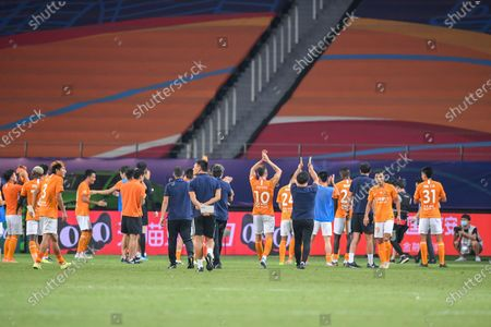 Players of Wuhan Zall greet their supporters after the 9th round match between Wuhan Zall and Beijing Guoan at the postponed 2020 season Chinese Football Association Super League (CSL) Suzhou Division in Suzhou, east China's Jiangsu Province, Sept. 6, 2020.