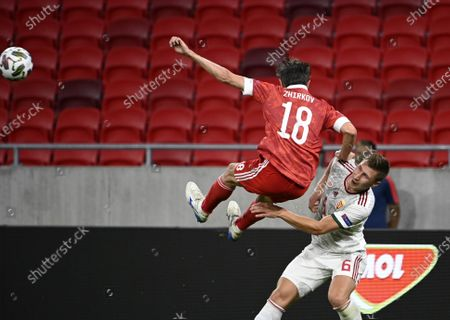 Hungarian Willi Orban(L) and Russian Yuri Zhirkov fight for the ball during the UEFA Nations League group 3 soccer match between Hungary and Russia in the Puskas Ferenc Arena in Budapest, Hungary, 06 September 2020.