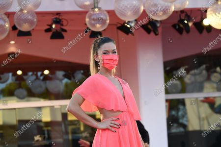 Alice Bellagamba wears a face mask as she arrives for the premiere of 'The World to Come' during the 77th annual Venice International Film Festival, in Venice, Italy, 06 September 2020. The movie is presented in the official competition 'Venezia 77' at the festival running from 02 September to 12 September. The event is the first major in-person film fest to be held in the wake of the Covid-19 coronavirus pandemic. Attendees have to follow strict safety measures like mandatory face masks indoors, temperature scanners, and socially distanced screenings to reduce the risk of infection. The public is barred from the red carpet, and big stars are expected to be largely absent this year.