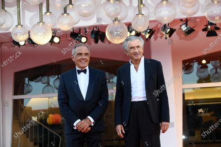 Venice Film Festival Director Alberto Barbera (L) and French philosopher, writer and director Bernard-Henri Levy (R) attend the premiere of 'The World to Come' during the 77th annual Venice International Film Festival, in Venice, Italy, 06 September 2020. The movie is presented in the official competition 'Venezia 77' at the festival running from 02 September to 12 September. The event is the first major in-person film fest to be held in the wake of the Covid-19 coronavirus pandemic. Attendees have to follow strict safety measures like mandatory face masks indoors, temperature scanners, and socially distanced screenings to reduce the risk of infection. The public is barred from the red carpet, and big stars are expected to be largely absent this year.