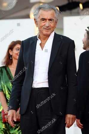 French philosopher, writer and director Bernard-Henri Levy arrives for the premiere of 'The World to Come' during the 77th annual Venice International Film Festival, in Venice, Italy, 06 September 2020. The movie is presented in the official competition 'Venezia 77' at the festival running from 02 September to 12 September. The event is the first major in-person film fest to be held in the wake of the Covid-19 coronavirus pandemic. Attendees have to follow strict safety measures like mandatory face masks indoors, temperature scanners, and socially distanced screenings to reduce the risk of infection. The public is barred from the red carpet, and big stars are expected to be largely absent this year.