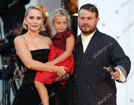 Mona Fastvold (L) arrives with her partner, US actor-director Brady Corbet, and their daughter for the premiere of 'The World to Come' during the 77th annual Venice International Film Festival, in Venice, Italy, 06 September 2020. The movie is presented in the official competition 'Venezia 77' at the festival running from 02 September to 12 September. The event is the first major in-person film fest to be held in the wake of the Covid-19 coronavirus pandemic. Attendees have to follow strict safety measures like mandatory face masks indoors, temperature scanners, and socially distanced screenings to reduce the risk of infection. The public is barred from the red carpet, and big stars are expected to be largely absent this year.