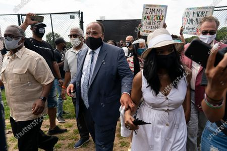 Martin Luther King, III and his wife Arndrea Waters King march from the Lincoln Memorial to the Martin Luther King Jr. Memorial during the March on Washington, in Washington