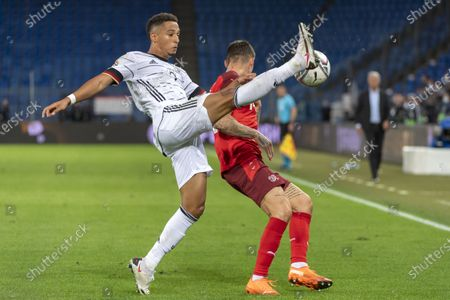 Germany's Thilo Kehrer, left, fights for the ball against Switzerland's Steven Zuber, right, during the UEFA Nations League group 4 soccer match between Switzerland and Germany at the St. Jakob-Park stadium in Basel, Switzerland, 06 September 2020.