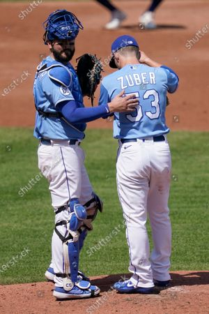 Kansas City Royals catcher Cam Gallagher, left, meets with relief pitcher Tyler Zuber (53) during the third inning of a baseball game against the Chicago White Sox at Kauffman Stadium in Kansas City, Mo