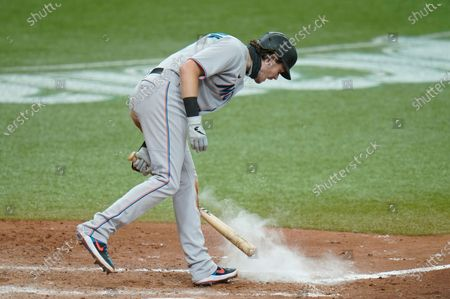 Miami Marlins' Brian Anderson slams his bat after striking out against Tampa Bay Rays relief pitcher John Curtiss during the 10th inning of a baseball game, in St. Petersburg, Fla