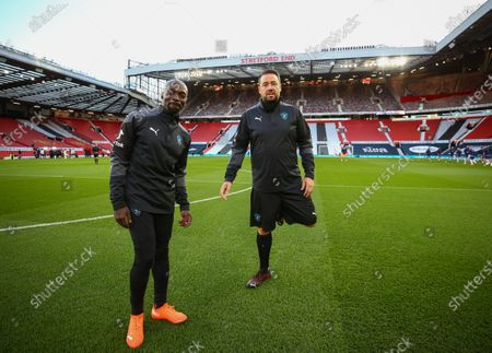 Soccer Aid World XI FC Claude Makelele and Jason Manford warm up on the pitch ahead of Soccer Aid for Unicef 2020 at Old Trafford, Manchester. For further information, please contact Head of Communications Niall Malone niall@socceraidproductions.com© Unicef/SAP/(WALTON)20Photographed by Ian Walton for Unicef UK and SAP LTD.06/09/2020