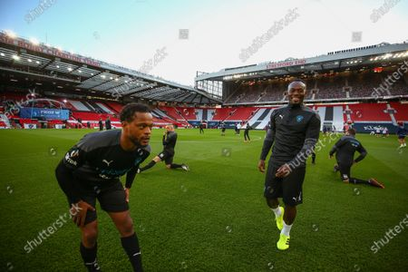 Patrice Evra and Michael Essien on the pitch ahead of Soccer Aid for Unicef 2020 at Old Trafford, Manchester. For further information, please contact Head of Communications Niall Malone niall@socceraidproductions.com© Unicef/SAP/(WALTON)20Photographed by Ian Walton for Unicef UK and SAP LTD.06/09/2020