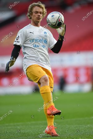 Stock Picture of Alfie Allen on the pitch ahead of ahead of Soccer Aid for Unicef 2020 at Old Trafford, Manchester