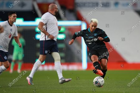 Tom Davis of England and Lianne Sanderson of Soccer Aid World XI FC are pictured playing in Soccer Aid for Unicef 2020 at Old Trafford, Manchester.