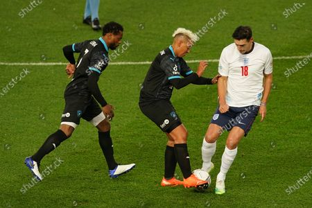 Gareth Barry [right] of England, Patrice Evra [left] & Lianne Sanderson [centre] of Soccer Aid World XI FC are pictured playing in Soccer Aid for Unicef 2020 at Old Trafford, Manchester.