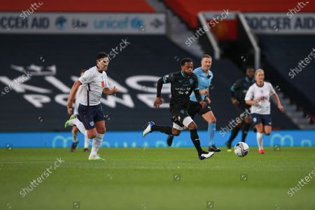 Jeremy Lynch of Soccer Aid World XI FC and Gareth Barry of England are pictured playing in Soccer Aid for Unicef 2020 at Old Trafford, Manchester.