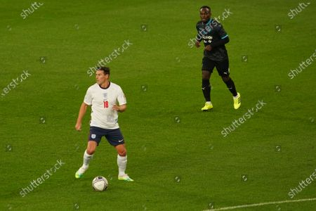 Stock Picture of Gareth Barry of England and Michael Essien of Soccer Aid World XI FC are pictured playing in Soccer Aid for Unicef 2020 at Old Trafford, Manchester.