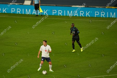 Stock Image of Gareth Barry of England and Michael Essien of Soccer Aid World XI FC are pictured playing in Soccer Aid for Unicef 2020 at Old Trafford, Manchester.
