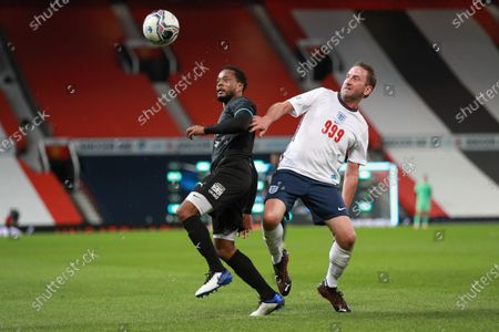 Lee Mack of England and Patrice Evra of Soccer Aid World XI FC are pictured playing in Soccer Aid for Unicef 2020 at Old Trafford, Manchester.